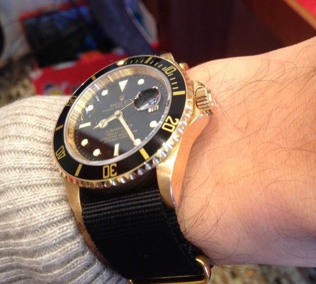 Rolex Submariner 16618 in gold on a NATO strap with gold hardware and buckle from #cheapestnatostraps.com #rolexsubmariner #rolex #submariner #diverswatch #natostrap #natoband #klocksnack #watchuseek #watchesofinstagram #instawatch