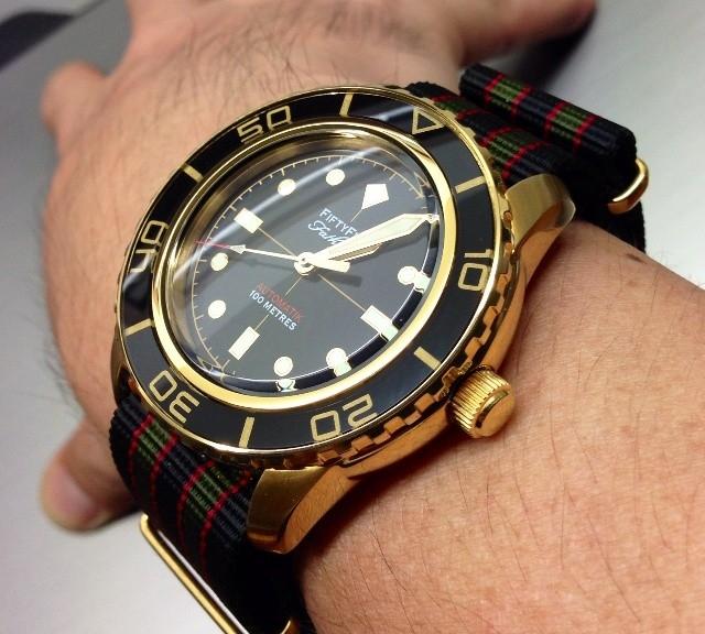 Fiftyfive on a James Bond striped gold NATO strap from #cheapestnatostraps.com #fiftyfive #jamesbond #natostrap #natoband #goldwatch