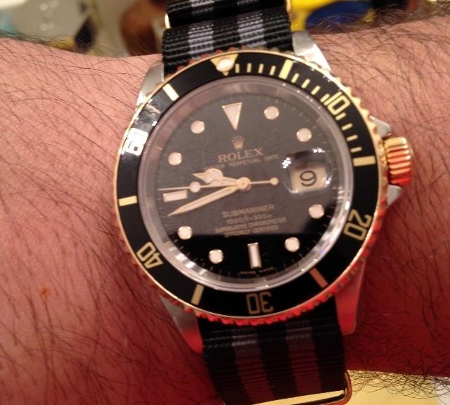 Rolex Submariner two tone on a James Bond striped NATO strap from #cheapestnatostraps.com #rolexsubmariner #rolex #submariner #goldwatch #diverswatch #natostrap #natoband #klocksnack #watchuseek