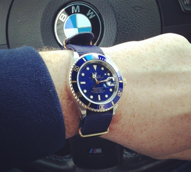 Rolex Submariner with blue bezel on a gold NATO strap from #cheapestnatostraps.com #rolexsubmariner #submariner #rolex #goldwatch #natostrap #natoband #klocksnack #watchuseek #watchband #watchstrap