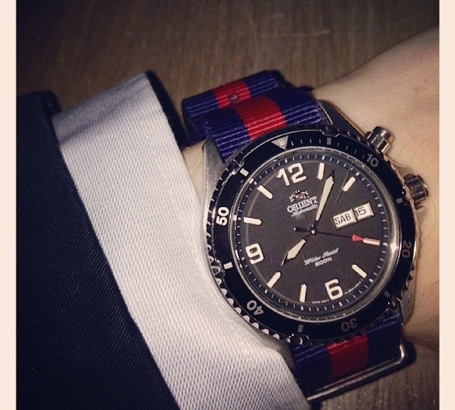 Orient on a navy and red NATO strap from #cheapestnatostraps  #orient #watchband #natostrap #instawatch #wtistporn #watchoftheday